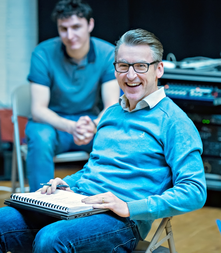 Director James Brining in rehearsals for Sunshine on Leith. Photography by Anthony Robling